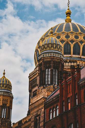 architecture yellow and black domed building during daytime dome