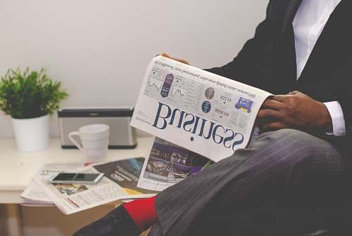 photo cup person sitting near table holding newspaper financial free for commercial use images