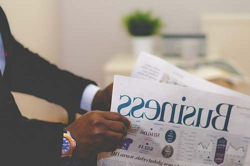 photo finance person wearing suit reading business newspaper newspaper free for commercial use images