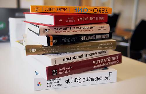 book pile of assorted-title books startup