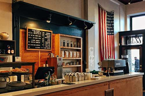 coffee flag of U.S. America hanging on white painted concrete wall shop