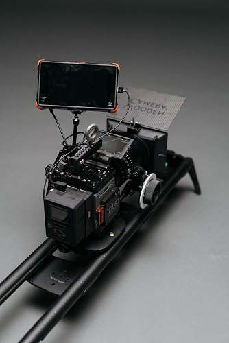 display black flat screen monitor attached to camera on rail machine