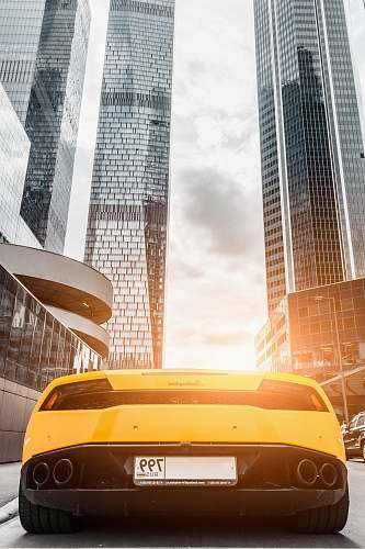 automobile parked yellow vehicle transportation