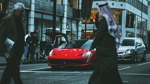 human red sports car in street people