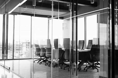 office grayscale photography of corporate room black-and-white
