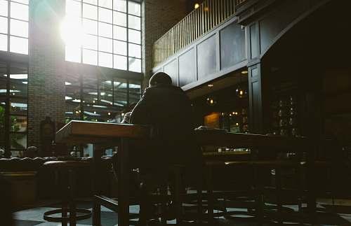 cafe man seating on bar stool furniture