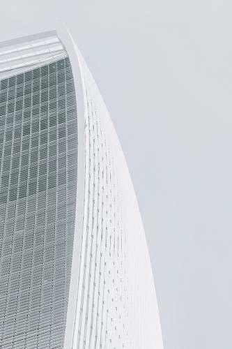 architecture white concrete multi-storey skyscraper at daytime grey