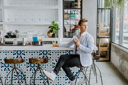 person man sitting on stool human