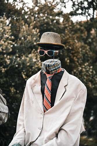 apparel necktie, hat, and sunglasses hat
