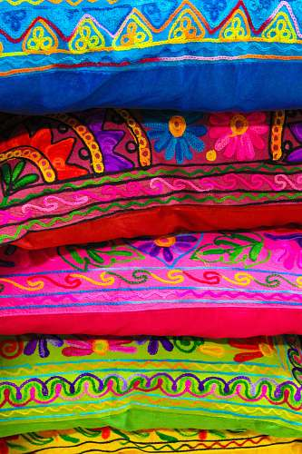 apparel stack of multicolored pillows quilt