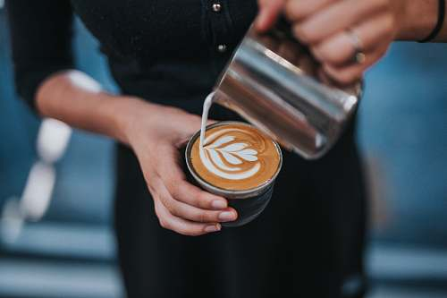 barista person holding coffee with latte cup food