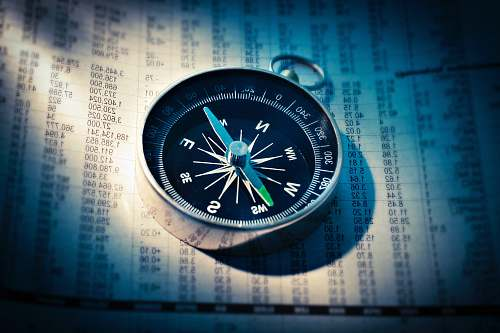 fund shallow focus photograph of black and gray compass stock exchange