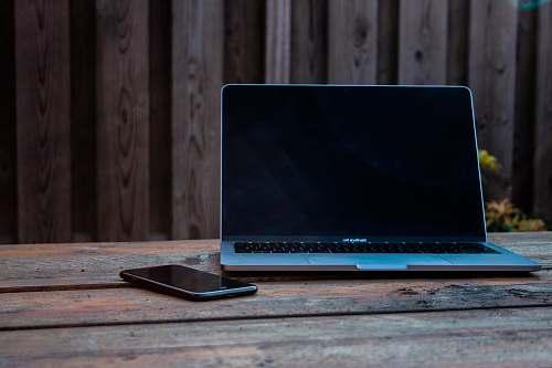electronics MacBook Pro on tabl laptop