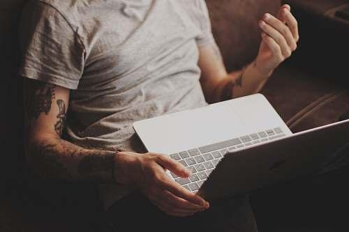 electronics person white laptop computer pc