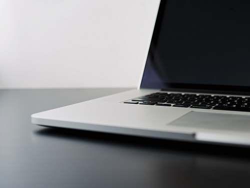 laptop silver laptop computer on black table tech