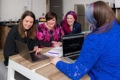 electronics woman waering blue cardigan using laptop pc