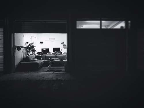 furniture black and white photo of couch building