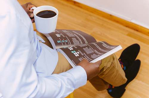 photo drink man holding coffee mug and reading magazine beverage free for commercial use images