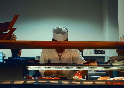 germany man preparing sushi dish eat