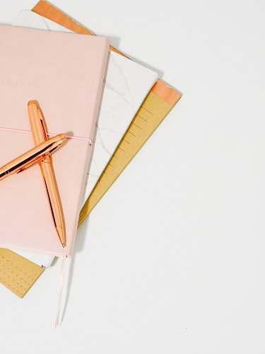 office ballpoint pens on pink notebook blog
