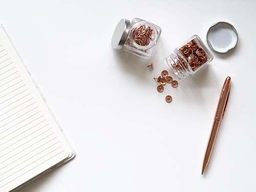 office stainless steel twist pen beside clear glass jars blog