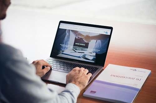 laptop man's hands on MacBook Pro pc