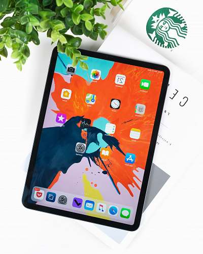 computer space gray iPad Pro on top of book tablet computer