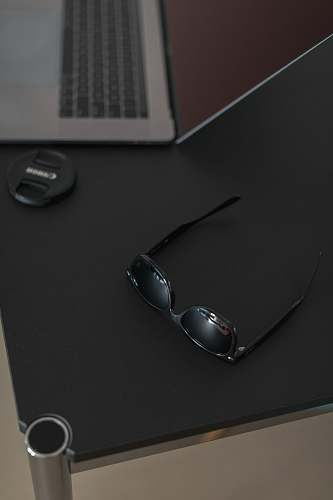 pc sunglasses on table computer