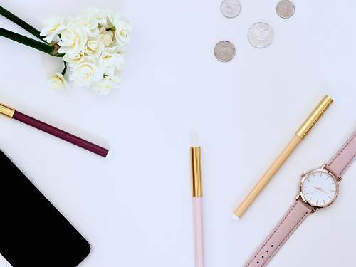 desktop flat lay photo of watch on top of table money