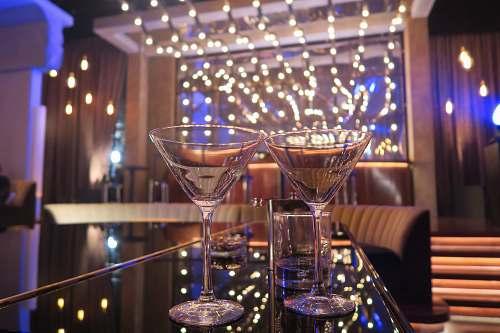 lighting two Martini glasses beverage