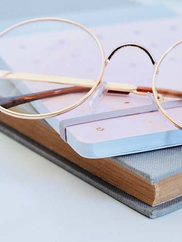 book eyeglasses on book work