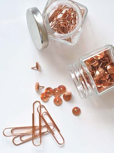 office brass thumbtacks and paper clips clips