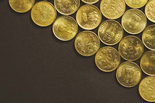 financing round gold-colored coins coin