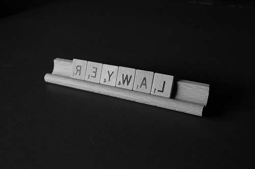 black-and-white brown wooden scrable law