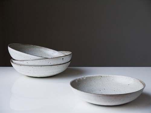 bowl four round white ceramic bowls on white surface turning earth ceramics