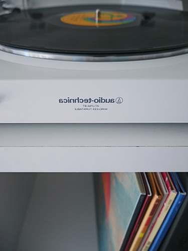 file white Audio-Technica wireless turntable near vinyl record sleeve record