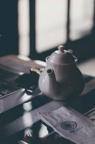 pot white ceramic teapot on table pottery