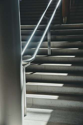 banister gray concrete stairs staircase