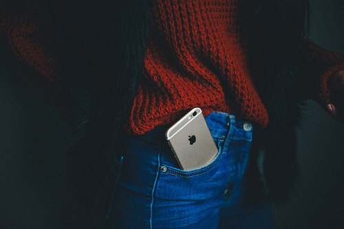person gold iPhone 6 on person's pocket people