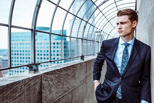suit man facing sideways people