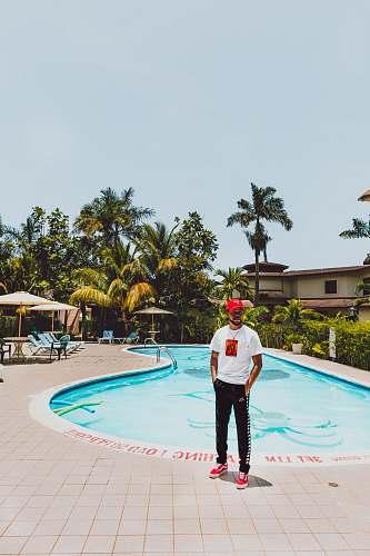 apparel man standing near pool person