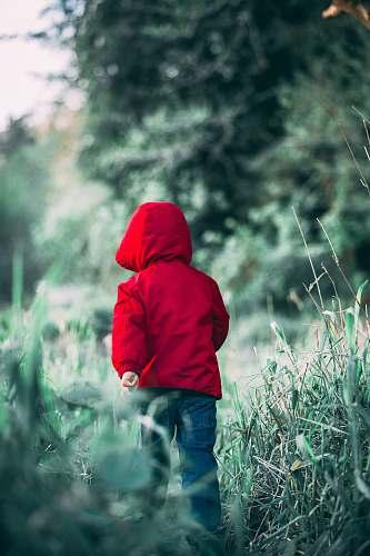 apparel toddler walking on grass field during daytime clothing