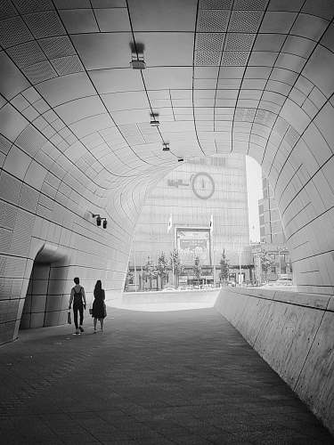 black-and-white white concrete tunnel during daytime grey