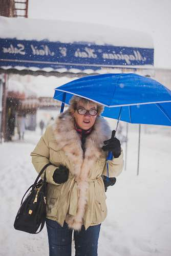 apparel woman holding blue umbrella clothing