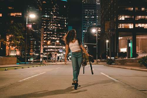 person woman holding DSLR camera apparel