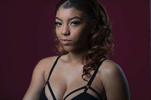 person woman wearing black bra face