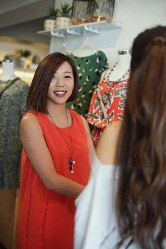 person woman wearing orange sleeveless dress apparel