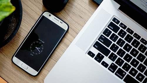 electronics smartphone beside MacBook Pro phone