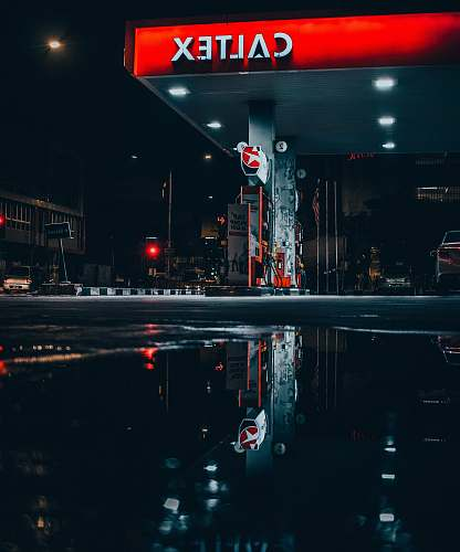 malaysia landscape photo of Caltex gasoline station puddle