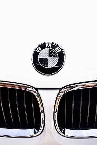 logo close-up photography of white BMW vehicle new zealand